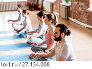 Купить «group of people making yoga exercises at studio», фото № 27134008, снято 5 марта 2017 г. (c) Syda Productions / Фотобанк Лори