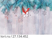 Купить «New Year and Christmas background. Christmas toys, blue fir tree branches on the wooden background. New Year still life», фото № 27134452, снято 8 мая 2017 г. (c) Зезелина Марина / Фотобанк Лори
