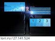 Купить «businessman with stock charts on virtual screens», фото № 27141524, снято 9 марта 2017 г. (c) Syda Productions / Фотобанк Лори