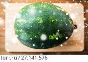 Купить «close up of watermelon on cutting board», фото № 27141576, снято 5 августа 2016 г. (c) Syda Productions / Фотобанк Лори