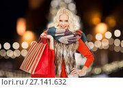 Купить «young woman in winter clothes with shopping bags», фото № 27141632, снято 2 октября 2011 г. (c) Syda Productions / Фотобанк Лори