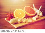 Купить «citrus, ginger, garlic and rowanberry on wood», фото № 27141676, снято 13 октября 2016 г. (c) Syda Productions / Фотобанк Лори
