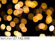 Купить «blurred golden lights over dark background», фото № 27142008, снято 7 сентября 2017 г. (c) Syda Productions / Фотобанк Лори