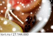 Купить «close up of cinnamon on plate», фото № 27144880, снято 13 октября 2016 г. (c) Syda Productions / Фотобанк Лори
