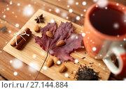 Купить «cup of tea, maple leaf and almond on wooden board», фото № 27144884, снято 13 октября 2016 г. (c) Syda Productions / Фотобанк Лори