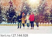 Купить «happy friends ice skating on rink outdoors», фото № 27144928, снято 22 декабря 2014 г. (c) Syda Productions / Фотобанк Лори