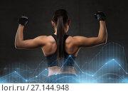 Купить «young woman flexing muscles in gym», фото № 27144948, снято 12 декабря 2015 г. (c) Syda Productions / Фотобанк Лори