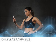 Купить «woman with smartphone and earphones in gym», фото № 27144952, снято 12 декабря 2015 г. (c) Syda Productions / Фотобанк Лори