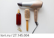 Купить «hairdryer, brush, hot styling hair spray and pins», фото № 27145004, снято 12 апреля 2017 г. (c) Syda Productions / Фотобанк Лори