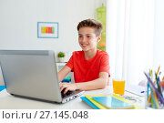 Купить «student boy typing on laptop computer at home», фото № 27145048, снято 10 июня 2017 г. (c) Syda Productions / Фотобанк Лори