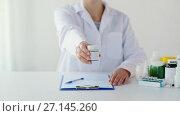 Купить «doctor with medicine and clipboard at hospital», видеоролик № 27145260, снято 21 июля 2018 г. (c) Syda Productions / Фотобанк Лори