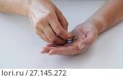 Купить «woman hands opening pack of medicine pills», видеоролик № 27145272, снято 21 июля 2018 г. (c) Syda Productions / Фотобанк Лори