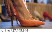 Купить «close up of female foot trying shoe at store», видеоролик № 27145844, снято 6 октября 2017 г. (c) Syda Productions / Фотобанк Лори