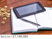 Купить «Business still life - tablet computer, diary, pen and coins on the businessman's desk», фото № 27148080, снято 12 апреля 2015 г. (c) Евгений Ткачёв / Фотобанк Лори