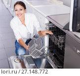 Купить «Woman choosing dish washing machine», фото № 27148772, снято 21 февраля 2020 г. (c) Яков Филимонов / Фотобанк Лори