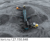 Купить «Open pit mine, breed sorting. Mining coal. Bulldozer sorts coal. Extractive industry, anthracite. Crushing marshalling complex. Coal industry.», фото № 27150848, снято 8 сентября 2017 г. (c) Сергей Тимофеев / Фотобанк Лори