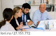 Купить «Employees are writing financial reports and discussing with mature boss in the office.», видеоролик № 27151772, снято 2 июля 2017 г. (c) Яков Филимонов / Фотобанк Лори