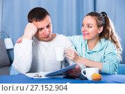 Купить «Couple struggling to pay bills», фото № 27152904, снято 18 марта 2017 г. (c) Яков Филимонов / Фотобанк Лори