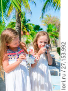 Купить «Adorable little girls with small turtles in hands in the natural reserve», фото № 27153992, снято 10 апреля 2017 г. (c) Дмитрий Травников / Фотобанк Лори