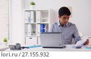 Купить «businessman with papers typing on laptop at office», видеоролик № 27155932, снято 22 августа 2019 г. (c) Syda Productions / Фотобанк Лори