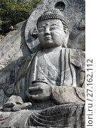 Купить «Дайбуцу Нихон-дзи вырезанный из камня, префектура Тиба, Япония», фото № 27162112, снято 11 февраля 2008 г. (c) Александр Гаценко / Фотобанк Лори