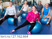 Купить «Adults doing aerobics with balls», фото № 27162664, снято 20 октября 2018 г. (c) Яков Филимонов / Фотобанк Лори