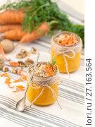 Купить «Carrot pudding with grated walnut on a tissue napkin.», фото № 27163564, снято 31 октября 2017 г. (c) Olesya Tseytlin / Фотобанк Лори