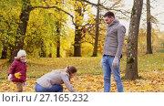 Купить «happy family playing with autumn leaves at park», видеоролик № 27165232, снято 18 ноября 2017 г. (c) Syda Productions / Фотобанк Лори