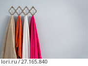 Купить «Colorful towels hanging on hook», фото № 27165840, снято 25 августа 2017 г. (c) Wavebreak Media / Фотобанк Лори