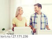 Купить «smiling couple with big boxes moving to new home», фото № 27171236, снято 25 февраля 2016 г. (c) Syda Productions / Фотобанк Лори