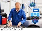 Купить «mechanic man with wrench repairing car at workshop», фото № 27171680, снято 1 июля 2016 г. (c) Syda Productions / Фотобанк Лори