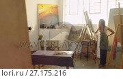 Купить «Artists painting on canvas 4k», видеоролик № 27175216, снято 23 апреля 2019 г. (c) Wavebreak Media / Фотобанк Лори