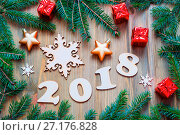 Купить «Happy New Year 2018 background with 2018 figures, Christmas toys, blue fir tree branches. New Year 2018 still life», фото № 27176828, снято 29 ноября 2016 г. (c) Зезелина Марина / Фотобанк Лори