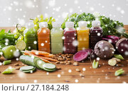 Купить «bottles with different fruit or vegetable juices», фото № 27184248, снято 5 августа 2016 г. (c) Syda Productions / Фотобанк Лори