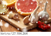 Купить «citrus, ginger, garlic and rowanberry on wood», фото № 27184264, снято 13 октября 2016 г. (c) Syda Productions / Фотобанк Лори
