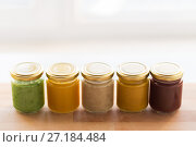 Купить «vegetable or fruit puree or baby food in jars», фото № 27184484, снято 21 февраля 2017 г. (c) Syda Productions / Фотобанк Лори