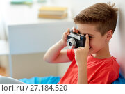 Купить «happy boy with film camera photographing at home», фото № 27184520, снято 10 июня 2017 г. (c) Syda Productions / Фотобанк Лори
