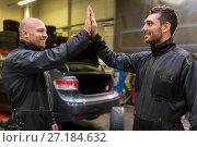 Купить «auto mechanics making high five at car shop», фото № 27184632, снято 21 сентября 2017 г. (c) Syda Productions / Фотобанк Лори