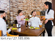 Купить «Unpleased client talking with manager in restaurant», фото № 27185896, снято 17 января 2017 г. (c) Яков Филимонов / Фотобанк Лори