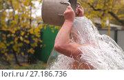 Купить «Man pours cold water», видеоролик № 27186736, снято 6 ноября 2017 г. (c) Илья Шаматура / Фотобанк Лори