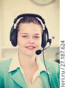 Купить «Female employee having a productive day at call-centre», фото № 27187624, снято 9 июня 2017 г. (c) Яков Филимонов / Фотобанк Лори