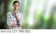 Купить «Businesswoman hushing quietness with finger in nature», фото № 27188352, снято 25 апреля 2019 г. (c) Wavebreak Media / Фотобанк Лори