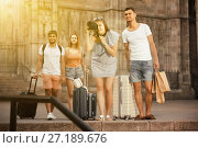 Купить «Young smiling woman and man tourists are holding camera in hands», фото № 27189676, снято 22 июня 2017 г. (c) Яков Филимонов / Фотобанк Лори