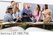 Купить «Different age students during break», фото № 27189716, снято 17 декабря 2018 г. (c) Яков Филимонов / Фотобанк Лори