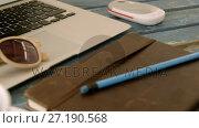 Купить «Coffee, organizer, pencil, sunglasses and laptop on table 4k», видеоролик № 27190568, снято 11 июля 2020 г. (c) Wavebreak Media / Фотобанк Лори
