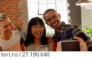 Купить «Group of executives reviewing picture on mobile phone 4k», видеоролик № 27190640, снято 25 июня 2018 г. (c) Wavebreak Media / Фотобанк Лори