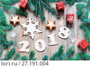 Купить «Happy New Year 2018 background with 2018 figures, Christmas toys, blue fir tree branches. New Year 2018 still life», фото № 27191004, снято 29 ноября 2016 г. (c) Зезелина Марина / Фотобанк Лори