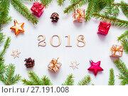 Купить «New Year 2018 background with 2018 figures,Christmas toys, fir branches-New Year 2018 composition», фото № 27191008, снято 30 ноября 2016 г. (c) Зезелина Марина / Фотобанк Лори