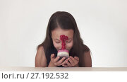 Купить «Beautiful naughty teenage girl joyfully smears cake face on white background stock footage video», видеоролик № 27192532, снято 1 ноября 2017 г. (c) Юлия Машкова / Фотобанк Лори