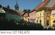 Купить «Medieval streets of Sighisoara with famous clock tower, Transylvania, Romania», видеоролик № 27192672, снято 16 сентября 2017 г. (c) Яков Филимонов / Фотобанк Лори